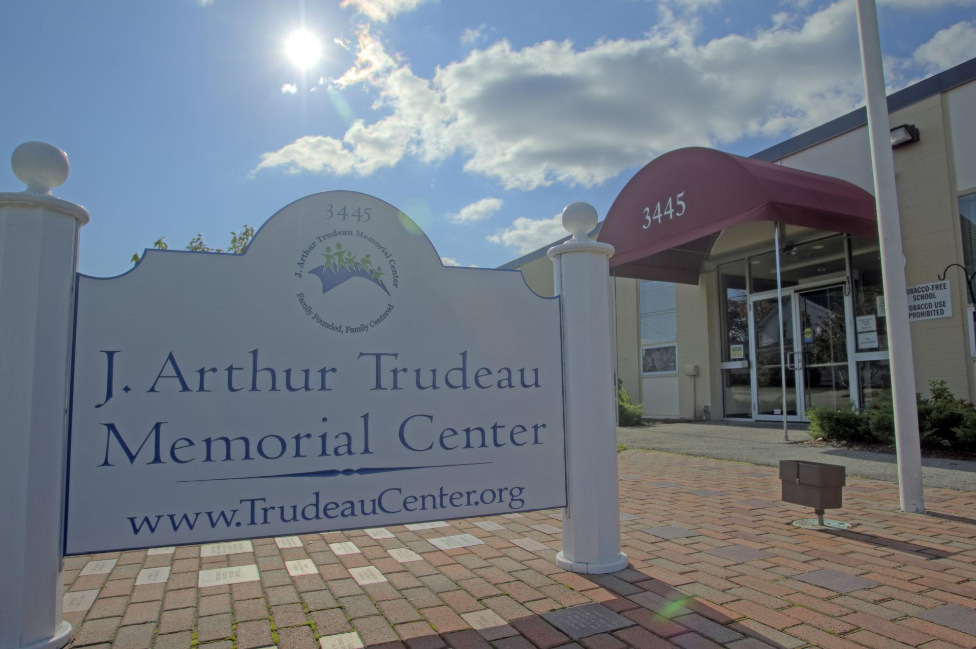 Trudeau Memorial Center logo